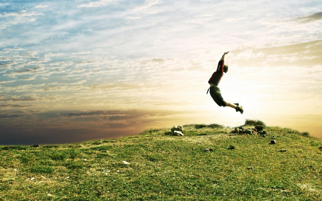 nature_grass_people_jump_sky_1280x800_37510.jpg